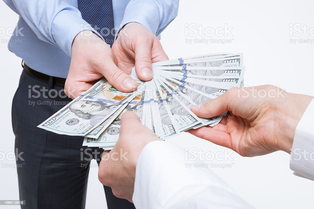 Business people holding dollars stock photo