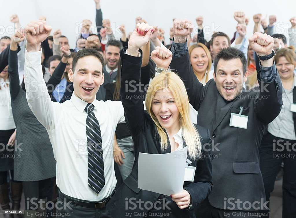 Business people holding fists up. royalty-free stock photo