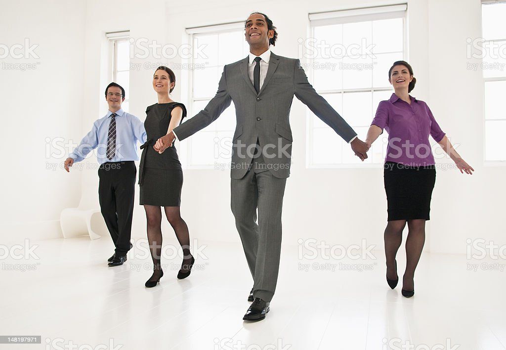 Business people holding hands in office royalty-free stock photo