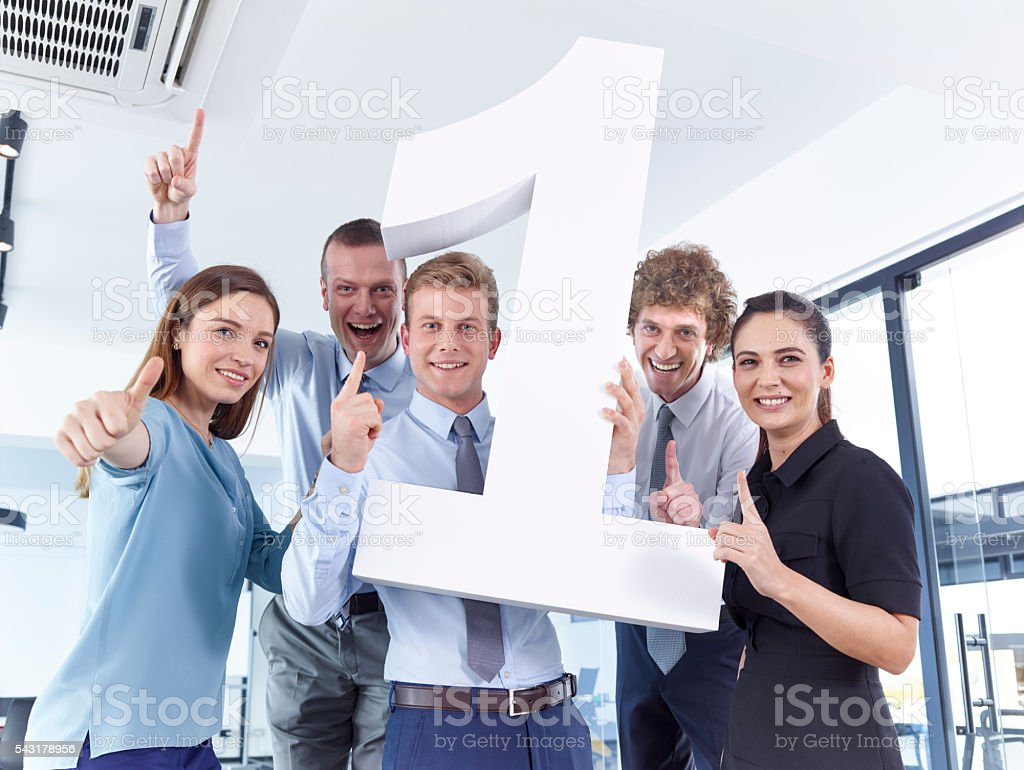 Business people holding large number 1 stock photo