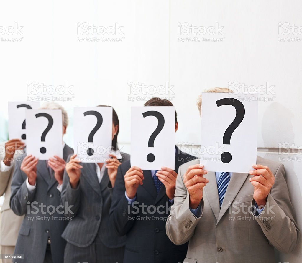 Business people holding ? Place cards over their faces royalty-free stock photo