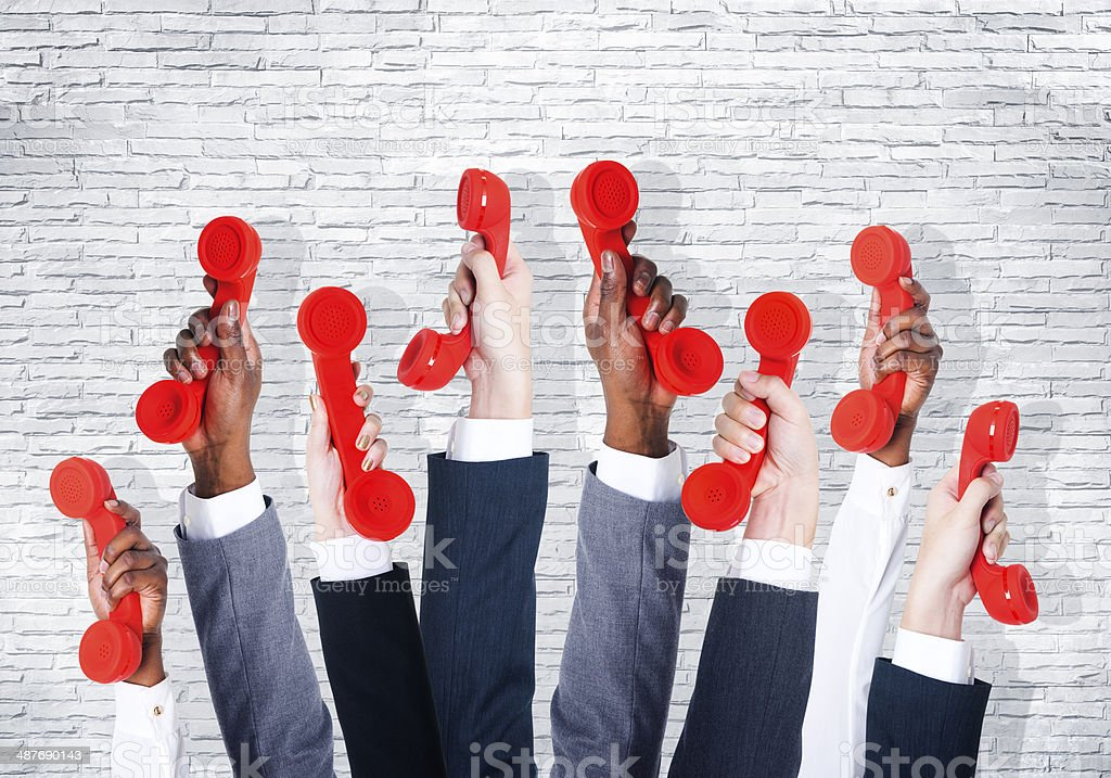 Business People Holding Red Phone stock photo