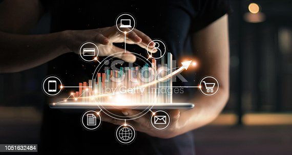 istock Business people holding tablet and statics graph chart growing in e-commerce global market and icon customer network connection on virtual interface. Arrow graph corporate future growth plan. Digital Online Marketing. Business ecommerce  technology. 1051632484