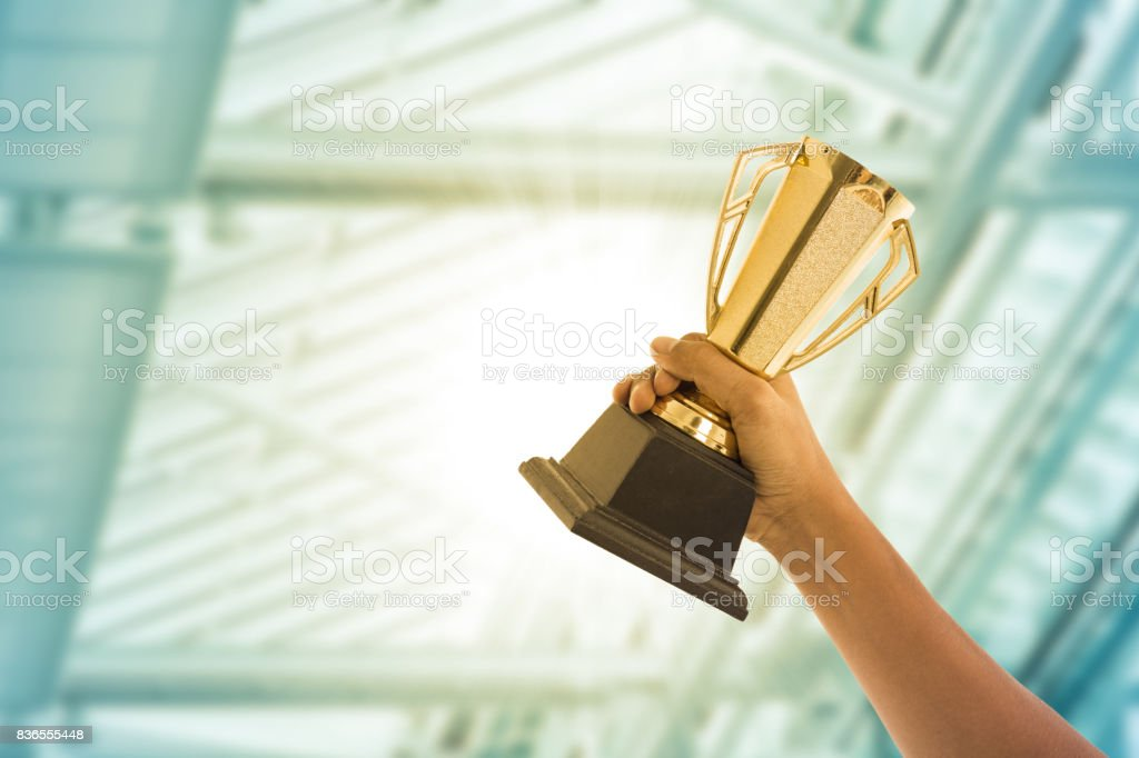Business people holding trophy award stock photo