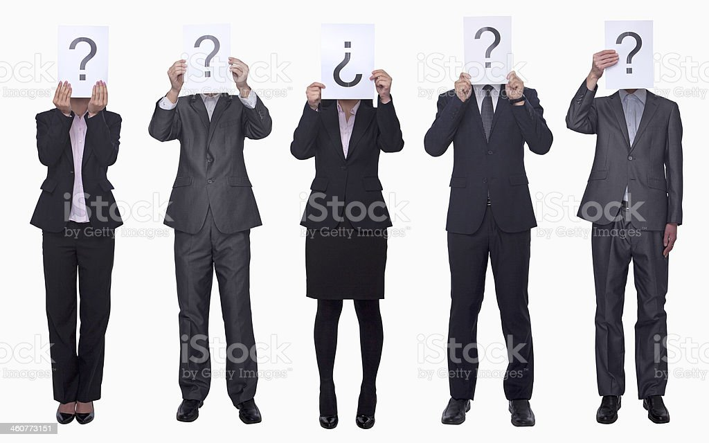 Business people holding up paper with question mark royalty-free stock photo