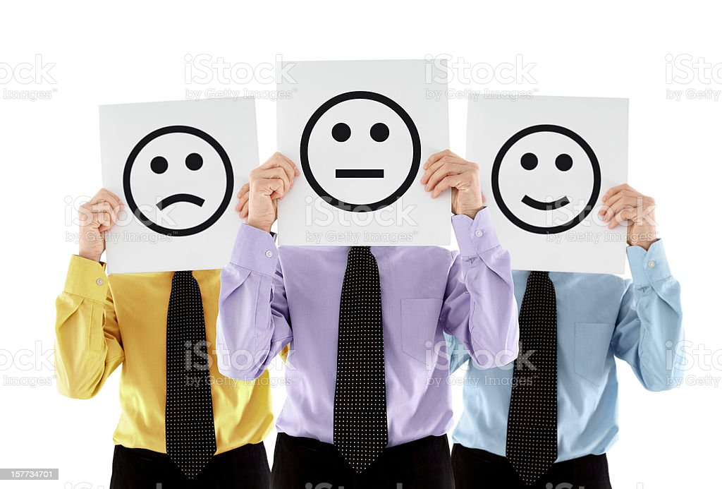 Business people holding various emoticons royalty-free stock photo