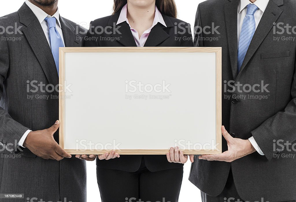 Business people holding whiteboard royalty-free stock photo