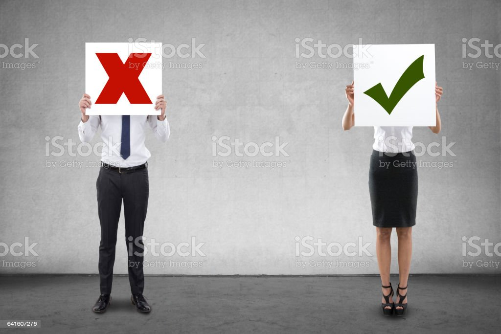 Business people holding wrong and right sign stock photo