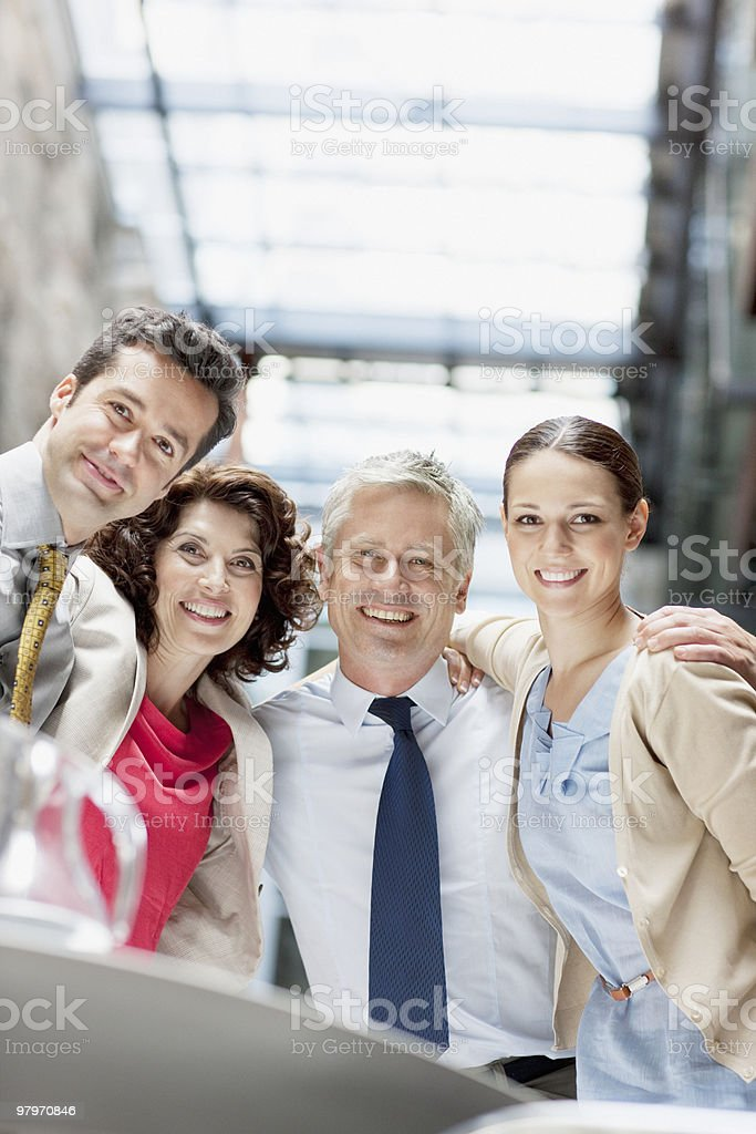 Business people hugging royalty-free stock photo