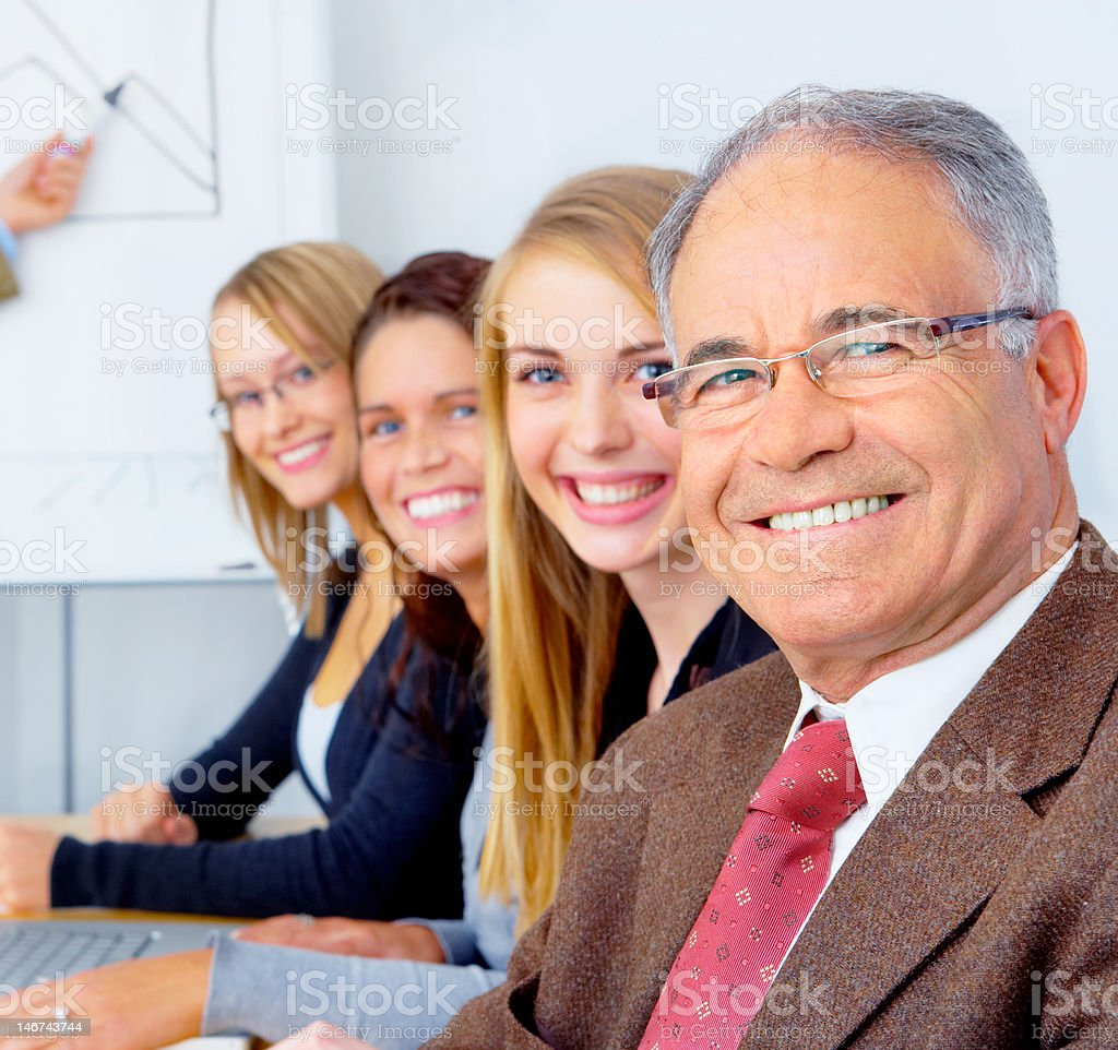 Business people in a board room royalty-free stock photo