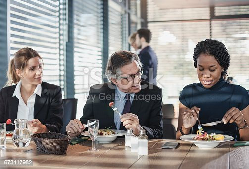 istock Business people in a cafe restaurant on a lunch break 673417982