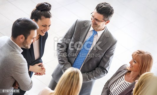 istock Business people in a casual meeting. 619270416