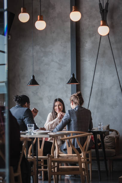 Business people in a high-end restaurant stock photo