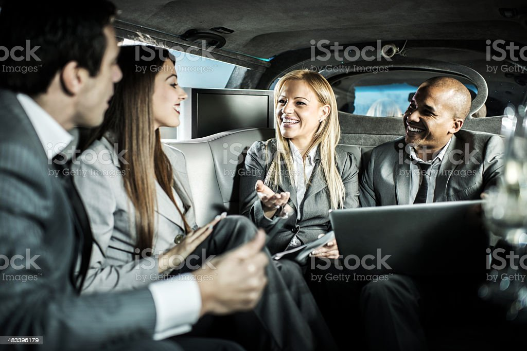 Business people in a limousine. stock photo