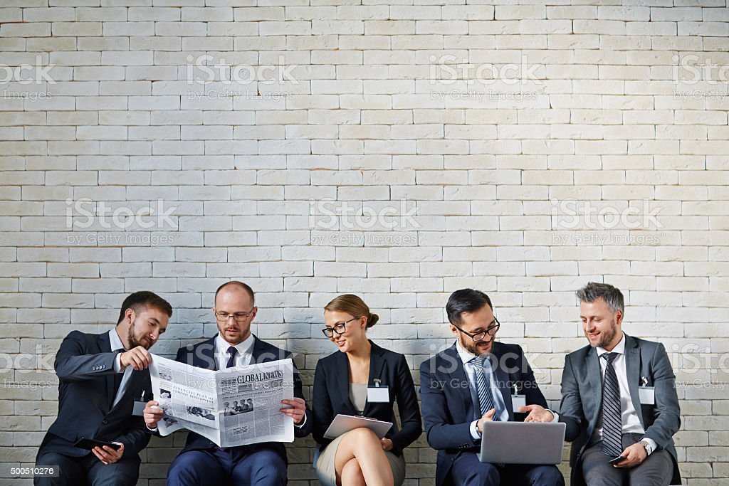 Business people in a line stock photo
