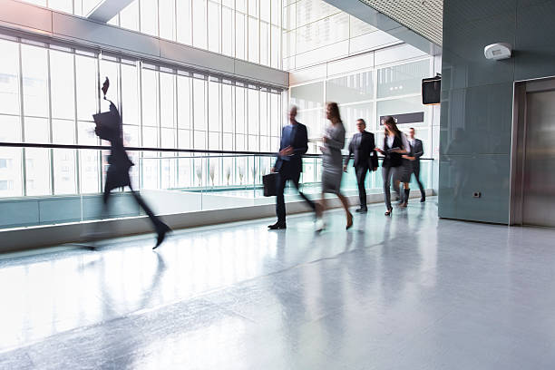 Business people in a lobby of an office building stock photo