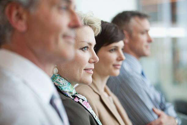 business people in a row - four lawyers stockfoto's en -beelden