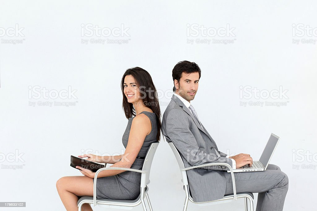 Business people in airport waiting room royalty-free stock photo