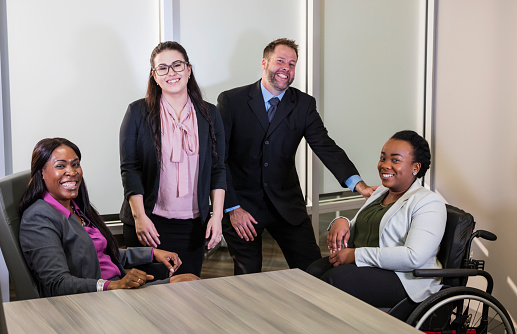 660681964 istock photo Business people in board room, one in wheelchair 1171432064