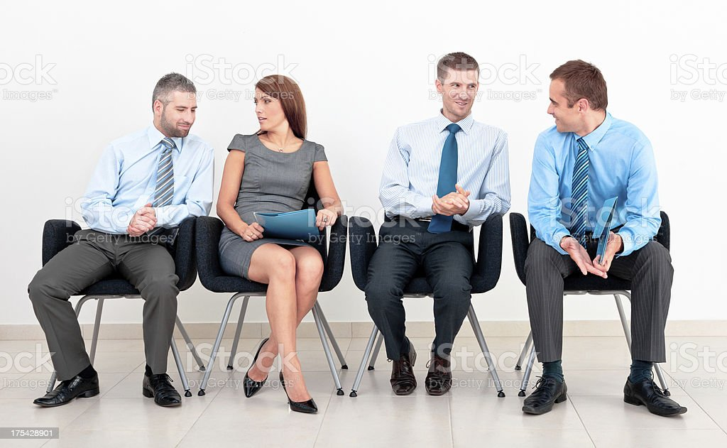 Business people in chairs Four business people sitting on chairs in a row and talking. 30-34 Years Stock Photo