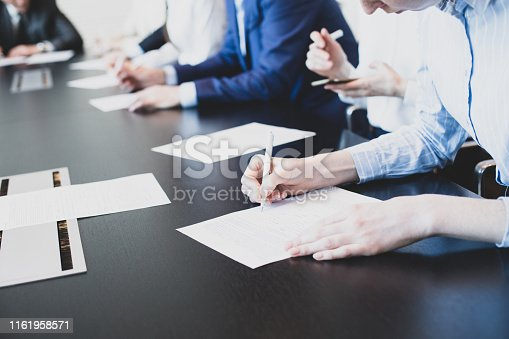 Business people working with documents in conference room