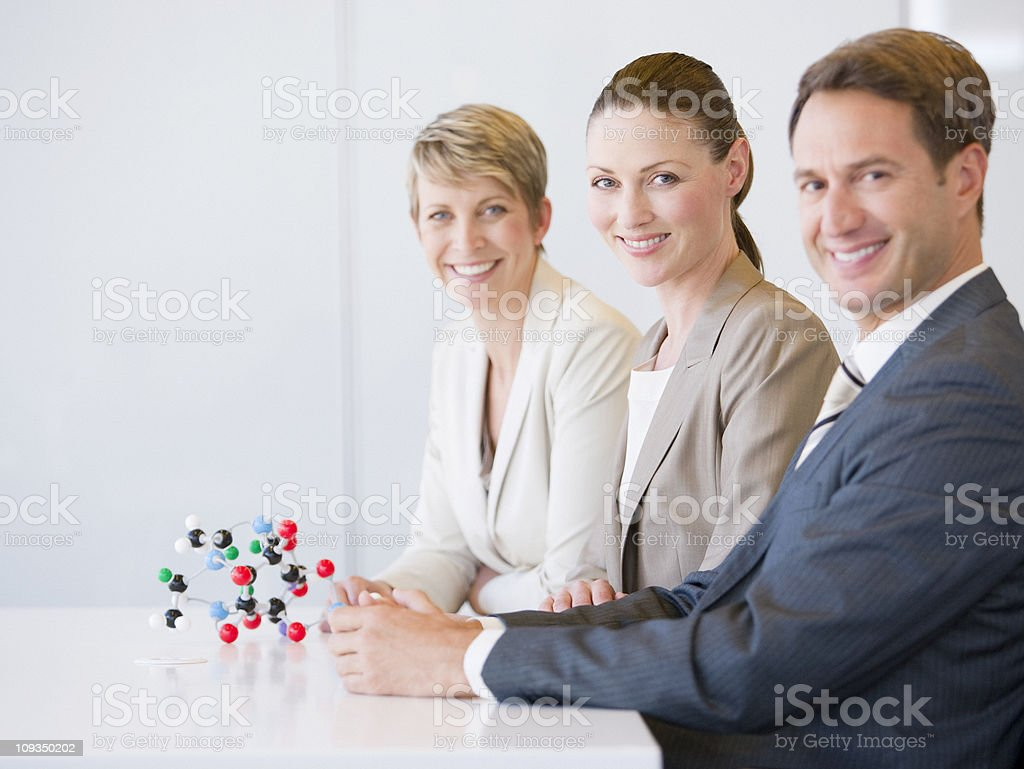 Business people in conference room with molecule model royalty-free stock photo