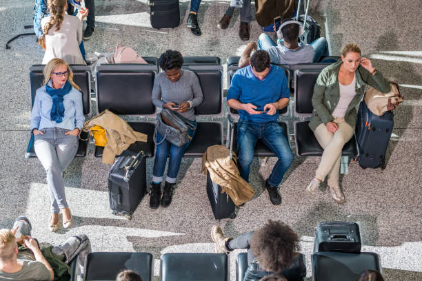 Business people in departure lounge stock photo