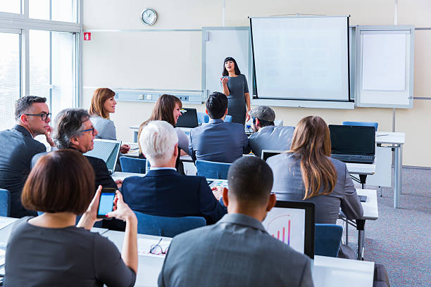 Business people in education room listening lecture stock photo