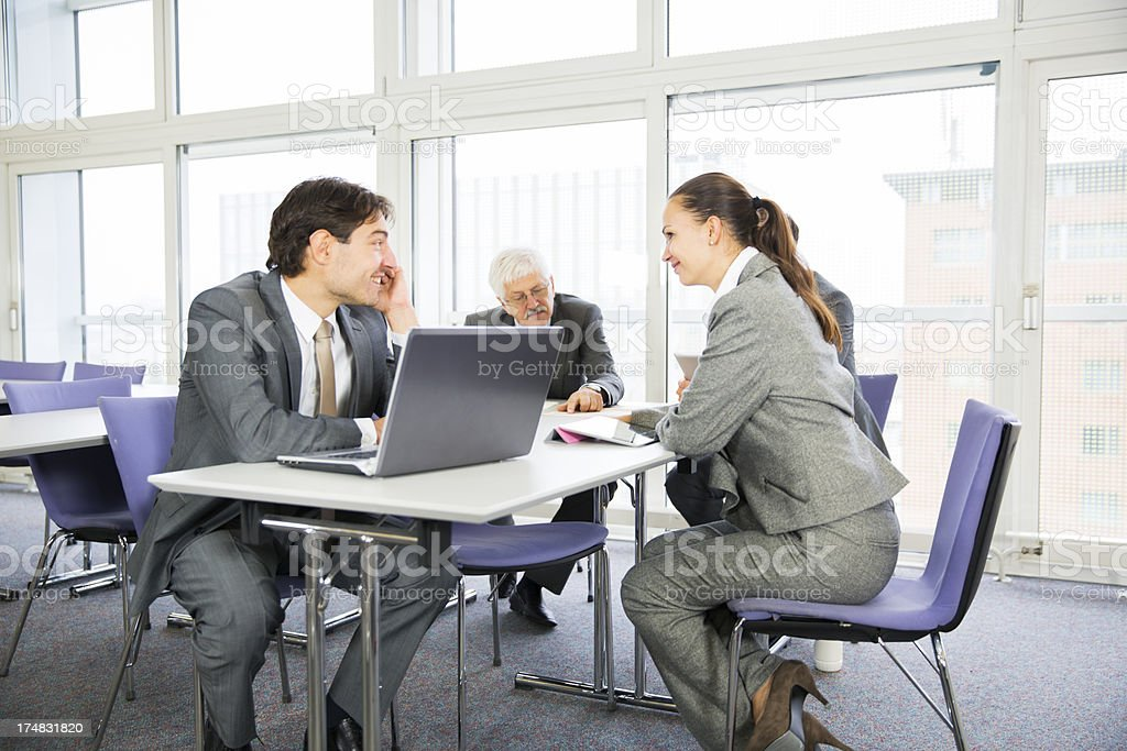 Business people in education room talking about their problems royalty-free stock photo