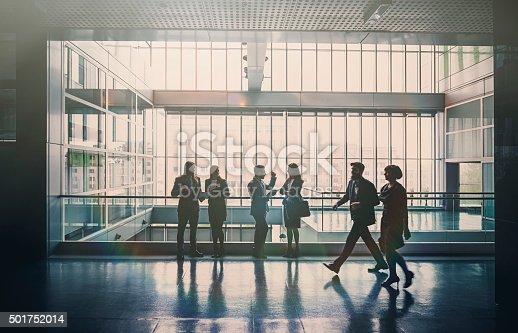 Business people in lobby walking