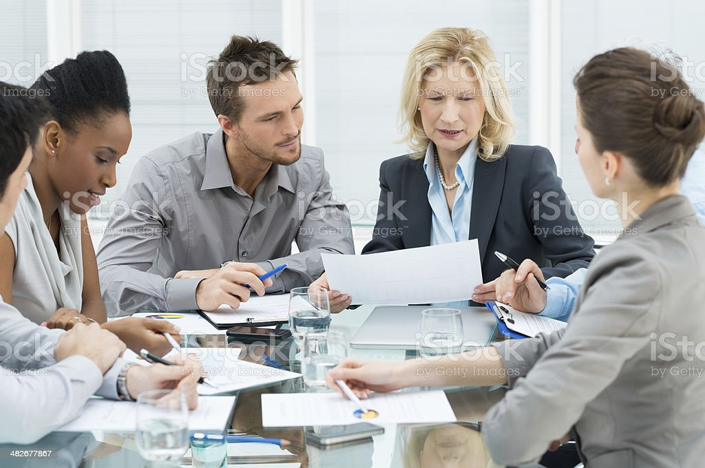 Business people in meeting at office table stock photo