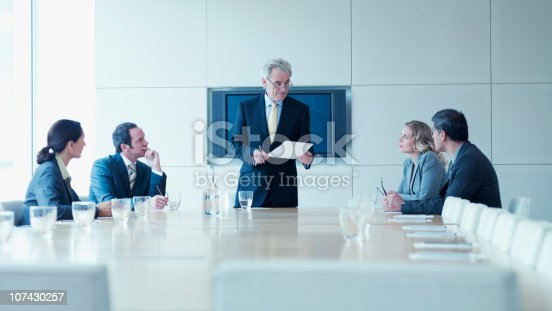 istock Business people in meeting in conference room 107430257