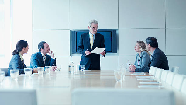 Business people in meeting in conference room stock photo