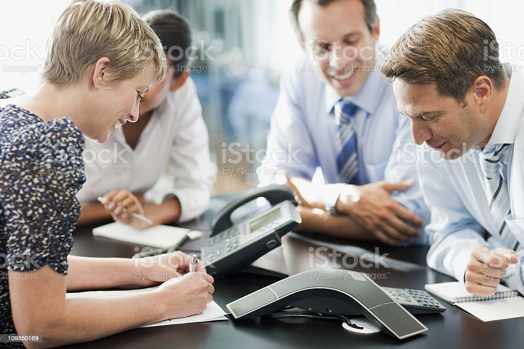 Business people in meeting on conference call stock photo