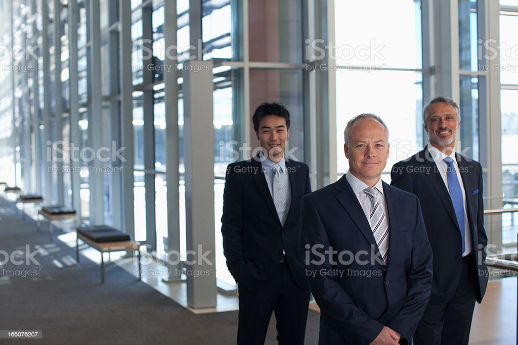 Business people in office lobby stock photo