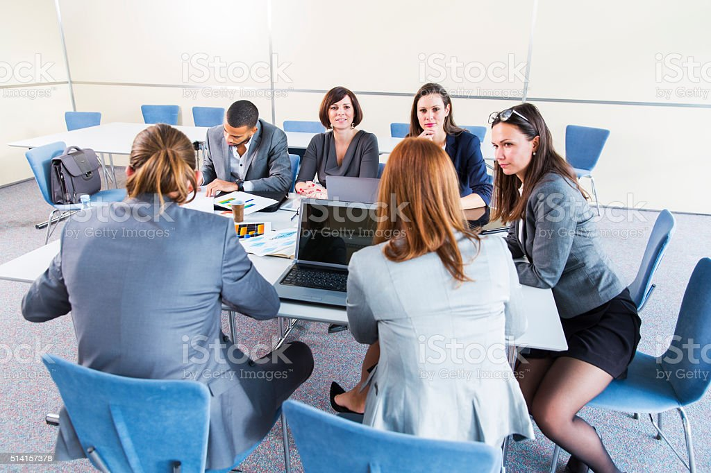 Business people in office talking about their problems,using laptop... stock photo