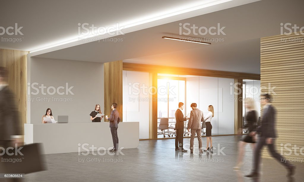 Business people in office with two receptionists stock photo