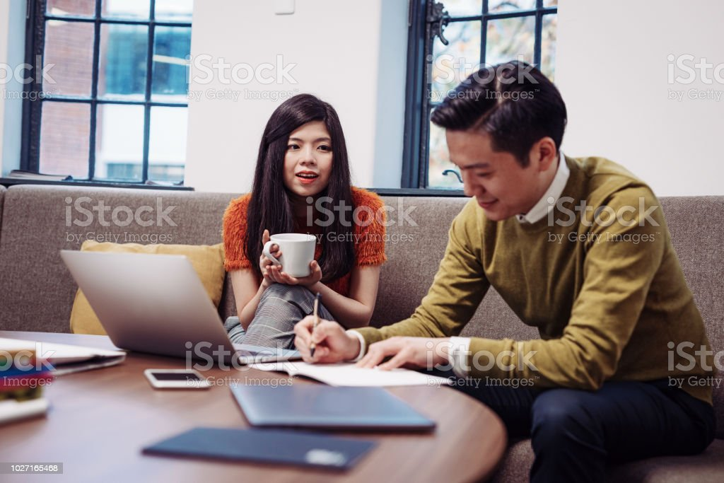 Chinese and Taiwanese adult business people working in modern...