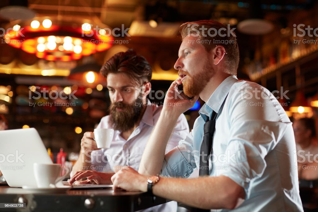 Business people in the bar royalty-free stock photo