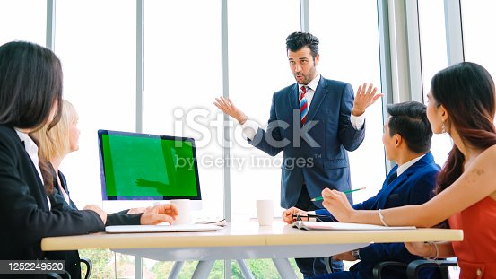 649403294 istock photo Business people in the conference room with green screen 1252249520