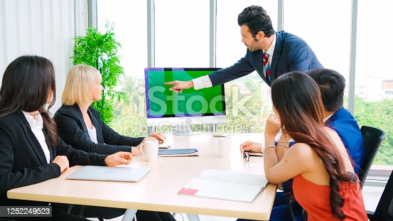 649403294 istock photo Business people in the conference room with green screen 1252249523