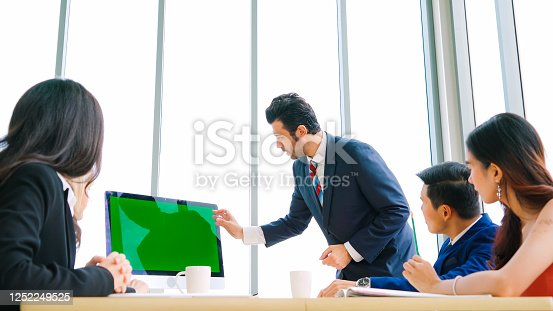 649403294 istock photo Business people in the conference room with green screen 1252249525