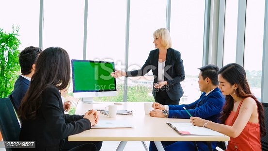 649403294 istock photo Business people in the conference room with green screen 1252249527