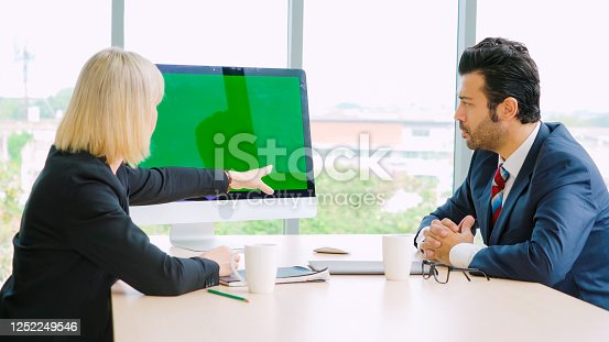 649403294 istock photo Business people in the conference room with green screen 1252249546
