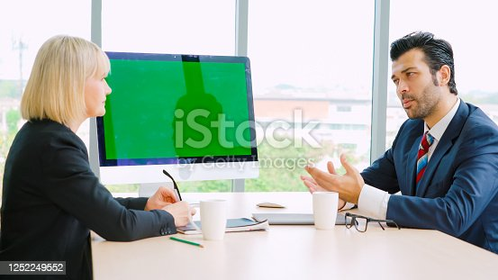 649403294 istock photo Business people in the conference room with green screen 1252249552