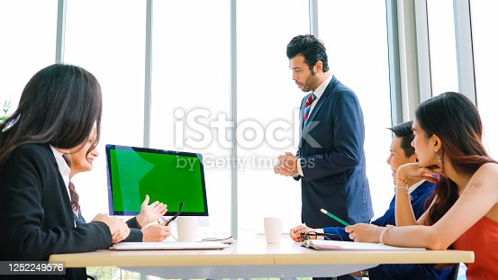 649403294 istock photo Business people in the conference room with green screen 1252249576