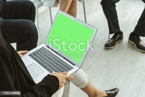 649403294 istock photo Business people in the conference room with green screen 1252249593