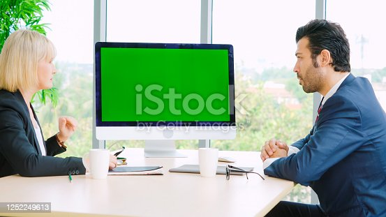 649403294 istock photo Business people in the conference room with green screen 1252249613