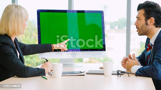 649403294 istock photo Business people in the conference room with green screen 1252249633