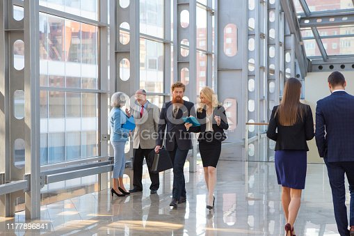 Business people walking in the lobby of a modern business center